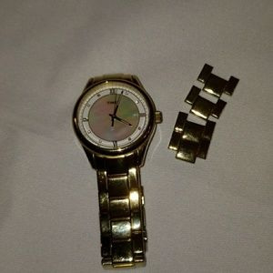 Timex Accessories - Timex mother of pearl & gold toned watch w/ date